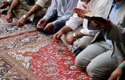Lamenting muslims in mosque. Muslim men singing a lament for their prophet Mohammed in a shiite mosque in Damascus, Syria Royalty Free Stock Image