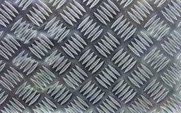 Lamina di metallo con l'ornamento del volume per uso come rivestimento antiscorrimento Fondo e struttura della lamina di metallo fotografia stock libera da diritti