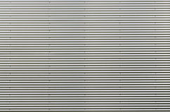 Lamina di metallo ondulata Modello del fondo di gray d'argento Immagini Stock Libere da Diritti