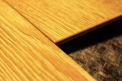 Laminate boards. Metering and laying of floor coverings. Repair the house with your own hands Stock Photo