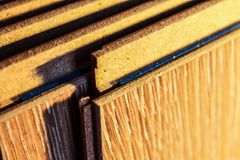 Laminate boards. Metering and laying of floor coverings. Repair the house with your own hands Stock Photography