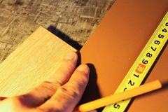 Laminate boards. Metering and laying of floor coverings. Repair the house with your own hands Royalty Free Stock Photo