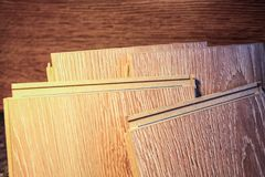 Laminate boards. Metering and laying of floor coverings. Repair the house with your own hands Royalty Free Stock Images