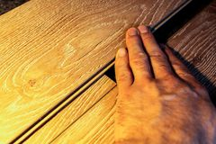 Laminate boards. Metering and laying of floor coverings. Repair the house with your own hands Stock Photos