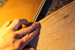 Laminate boards. Metering and laying of floor coverings. Repair the house with your own hands Royalty Free Stock Image