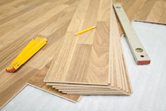 Laminate floor installation Royalty Free Stock Photos