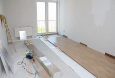 Laminate floor installation Royalty Free Stock Photos