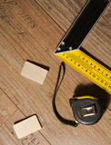 Laminate floor and tools used Royalty Free Stock Photography