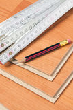 Laminate floor with wooden ruler  and pencil Royalty Free Stock Image