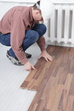 Laminate flooring installation Royalty Free Stock Image