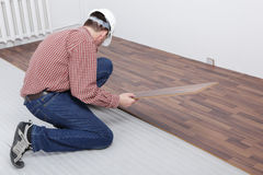 Laminate flooring installation Stock Photo