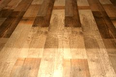 Laminate flooring under natural wooden boards on the floor Stock Photography