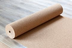 Substrate for a laminate. Laminate with a natural cortical substrate in a roll on the floor Stock Images