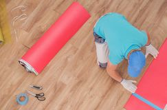 Laminate Panels Installation. Laminate Floor Panels Installation by Professional Caucasian Installer in His 30s. Flooring Job royalty free stock photo
