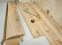 Laminate plates, imitating oak. Repair of flooring stock image