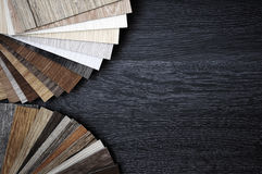 Laminate. Samples of laminate and vinyl floor tile on wooden Background Stock Images