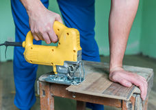 Laminate. Worker install the laminate floor royalty free stock image