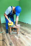 Laminate. Worker install the laminate floor stock images