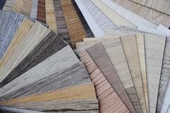 Laminated chipboards. ;laminate fomica and vinyl wood texture fl. Samples of laminate and vinyl floor tile on wooden Background Royalty Free Stock Photos