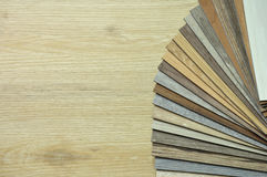 Laminated chipboards. wood texture floor,   Samples of laminate. Color palette for furniture on table close-up Stock Images