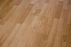 Laminated Floor Boards. Closeup of laminated wooden textured flooring Stock Photos