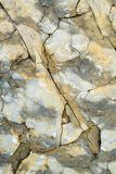 Laminated rocky surface from the riverbed of the mountain river Royalty Free Stock Photos
