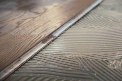 Laminated wooden boards instalaltion stock photos