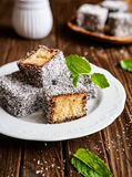 Lamington cakes with chocolate and coconut coating Royalty Free Stock Image