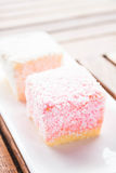 Lamington cakes on wood table Royalty Free Stock Photo