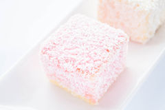 Lamington sponge cakes on the plate Royalty Free Stock Images
