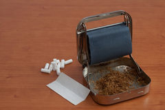Laminoir de cigarette image stock