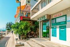 Lamma Post Office and Main street view in Yung Shue Wan village on Lamma Island in Hong Kong on sunny day. Hong Kong, China - January 25, 2016: Lamma Post Office stock photos