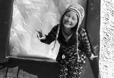 LAMO : Tourist Guide to Our trip to Spiti : Dhankar Village. A Cheerful Kid Who wouldshow us around her town giving a Heads up on do& x27;s and dont& x27;s & x28 royalty free stock images
