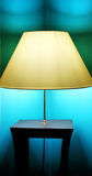 Lamp. Photo of yellow lamp on the table with blue wall stock images