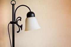 Lamp. An antique lamp with an old wallpaper background in an old hotel Royalty Free Stock Images