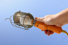 Lamp. Man holding a construction lamp Stock Image