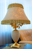 Lamp. Beautiful lamp cost(stand)s on table Stock Photos