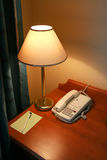 Lamp. And phone on a table in hotel Stock Photo