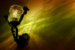 Lamp. Decorative lamp on a wall and colored illumination in a restarurant Stock Photo