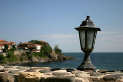 Lamp. And a city and sea on background; Sozopol, Bulgaria Royalty Free Stock Photography