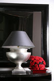 Lamp. Interior with a mirror, a lamp and red colors Stock Image