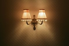Lamp. Two wall lights very Kitch in centre of frame royalty free stock photography