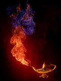 Lamp. Golden arabic oil lamp, fire background Royalty Free Stock Photos