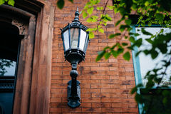 Lamp affixed to a house in Mount Vernon, Baltimore, Maryland. stock images