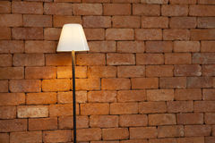 Lamp against brick wall Royalty Free Stock Photo