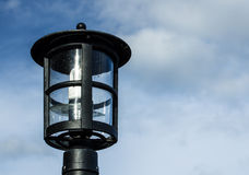 Lamp against the cloudy skies Stock Photography