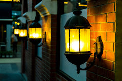 Lamp against a red brick wall at night. Royalty Free Stock Photos
