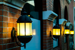 Lamp against a red brick wall at night. Royalty Free Stock Photo