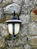 Lamp against stone wall background Royalty Free Stock Photos