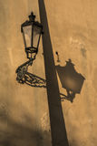 Lamp. Ancient lamp with shadow on the wall Royalty Free Stock Images